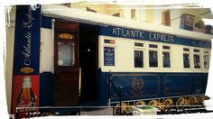 The Atlantic Express Train Restaurant is a historic and much loved restaurant in Cape Town's Sea Point area.  It offers excellent food and drink and a unique experience to boot.  To learn more, please see: http://tamlynamberwanderlust.com/?p=2852