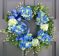blue hydrangeas   blue hydrangea wreath blue hydrangeas white berries and spring foliage