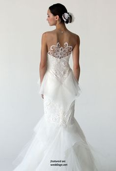 Love the Lace design on upper portion of the dress. Not a fan of the Lower Half.