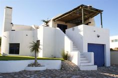Orpheus House - Orpheus House is a unique and cosy holiday home situated in Paradise Beach, next to Club Mykonos in Langebaan.  With breathtaking views of Saldanha Bay, this double-storey house has three bedrooms and ... #weekendgetaways #langebaan #southafrica