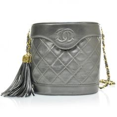 de9a9c529f89 This is an authentic CHANEL Vintage Quilted Lambskin Tassel Shoulder Bag in  Pewter. This stylish