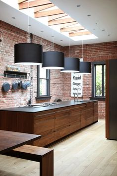 kitchen with industrial feel - exposed brick, raw timber and charcoal grey accent