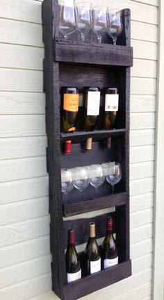 4 tier reclaimed wood wine rack. $120.00, via Etsy.