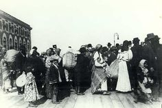 Immigrants with their belongings pictured outside the Main Building at Ellis Island.