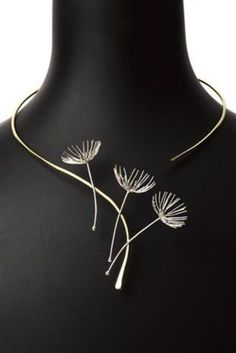 Dandelion Wishes.  This Tansy Wilson creation from the Make A Wish collection is a game-changer. Sure to make any ensemble stand out, this dandelion embellished work of art is a gorgeous addition to any outfit with a ballet, scoop, strapless or V neckline! Versatile, right? Then, what are you waiting for?