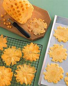 Made of oven-dried pineapple, these edible embellishments add sweetness, crunch, and color to a dessert that's already vibrant. The thinner you cut the slices, the faster they will dry -- and the brighter their yellow will be. When the pineapple core drie Pineapple Flowers, Dried Pineapple, Pineapple Upside, Flower Food, Flower Ideas, Flower Art, Martha Stewart Recipes, Dehydrated Food, Fruit Art