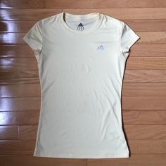 Adidas Workout tee USA size small. It is a light creamy almost yellowish color. Flaws are shown in second pic but as you can see are unnoticeable to the eye Adidas Tops Tees - Short Sleeve