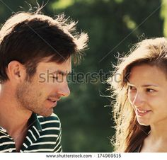 couple of cute young people said in the park summer day - stock photo