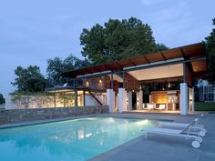 A pool and outdoor kitchen make entertaining easy: a grill, dishwasher, and sink are just steps away. Since the stovetop is situated under the porch roof, careful ventilation is required, McInturff says. Courtesy of: Julia Heine