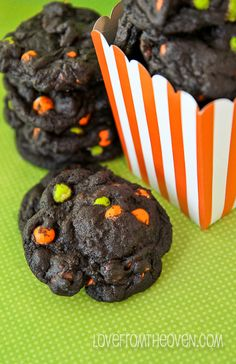Chocolate Chocolate Halloween Cookies:Double chocolate? Yes, please! Add Halloween-colored chocolate chips to the dough to create this sweet treat.Making this delicious cookies will be a breeze and a fun Halloween snacks for the  kids. Find more easy to make and decorate,quick and kid friendly Halloween cookie ideas here!