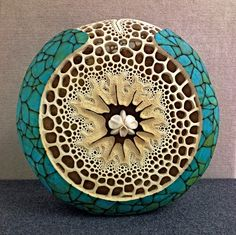 """The Beauty Within"" 16"" in diameter. Carving by Mark Doolittle; paper applique by Kathy Doolittle."