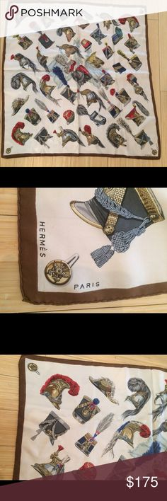 Hermes Scarf This is a lovely Casques et Coiffures Militaries  Hermes silk scarf. It is from 1959 and designed by Hugo Grygar. I fell in love with this piece at an estate sale but it has been sitting in my closet. This piece does have water marks throughout it, as well as some brown stains from what I assume is perfume. However they are hardly noticeable from a distance! I have taken pictures to show the marks. This piece has French helmets! It also has a brown border and is 90cm by 90cm…