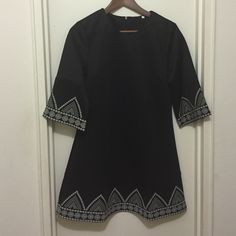 Black Round Neck Embroidered Loose Dress Material : polyester  Shoulder(cm) :38cm Bust(cm) :93cm Waist Size(cm) 88cm Length(cm) : 84.5cm Dresses Mini