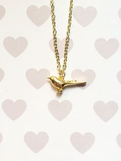 Bird Charm Necklace by strawberriesncreamm on Etsy