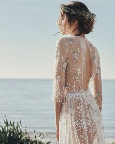 Wedding dress, translucent with silver and white bead detailing. Long and flowy beach wedding inspiration with an open back gown.