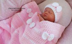 """This sweet little Peek A Bow hat and blanket set is a great pattern for the crochet beginner, and a cute set for any baby.Crocheted in a beautifully soft chenille yarn, the hat and blanket work up quickly. The yarn is fabulous to work with and is wonderfully soft and warm for baby. The blanket can be made with or without the bows. Finished size is 28"""" x 30"""".The sample was worked in James C. Brett Flutterby Chunky, but you could also use Bernat baby blanket chunky chenille, Universa..."""