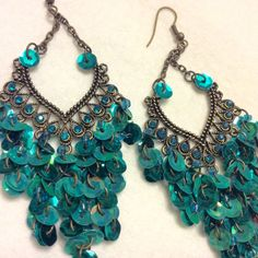 Vintage 1960's peacock colored sequins drop dangle cluster earrings. by vintageearrings715 on Etsy
