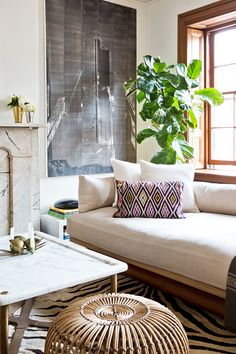 Cool and casual living room. Love that fiddle leaf fig!