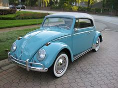 vintage powder blue on white vw bug convertible with white walls