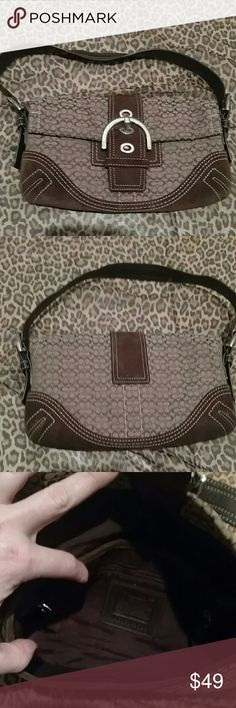 Coach soho mini bag Coach Soho baguette khaki and brown mini bag. Suede with leather handles. Excellent condition on outside. Inside had lipstick stains which were cleaned but marks were left. 10.5 inches wide, 5 inches deep. Shoulder strap is 8 inches long. Has 2 compartments inside and an additional one with a zipper. Does not have dust bag. No C05J-3628 Coach Bags Mini Bags