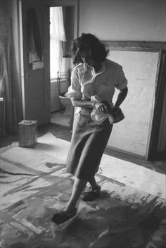USA. New York City. 1957. Painter Helen Frankenthaler uses slippered feet to create an Abstract Expressionist painting.