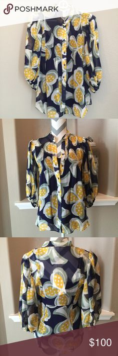 DVF Clover Pastel Blouse. S8818469J10 Beautiful navy pintucked front blouse with a navy tank. Bright beautiful yellow & white and green Clover Pastel design. 100% silk. Will fit up to size 2. Mannequin measurements/ 35 25 35 Diane von Furstenberg Tops
