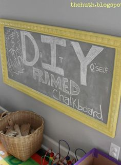 DIY framed Chalkboard--paint the gigantic framed picture for sale in the garage and use the left over chalkboard paint from our cabinet. Then attach to wall in the corner near the dog beds.