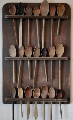 Old wooden spoons on display LOVEEEEE THIS. Wooden Spoon is 1 of my 3 top staples in the kitchen. The other two being a giant skillet & a Dutch oven! Wooden spoon # Soooo versatile yet sooo basic.