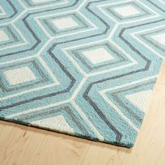 """Find your magical oasis and the perfect getaway from everyday life with our new Escape Collection! These fun geo printed Indoor/Outdoor rugs, will completely change your new destination, while making your room or patio the life of the party! Each rug is UV protected and handmade with 100% Polypropylene, complete with our special """"K-Stop Non-Skid Backing""""."""