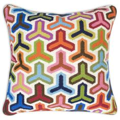 Bargello pillows, hand embroidered using long stitches to form elaborate geometric patterns.