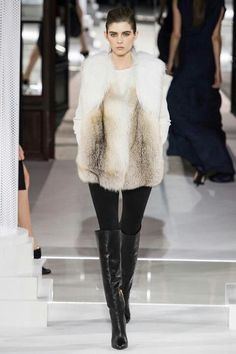 White fur vest with all black