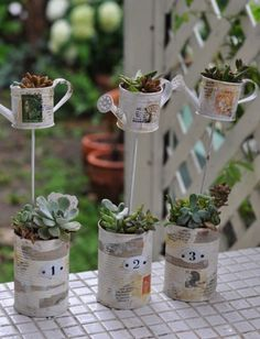 Upcycled tin can planter with miniature watering Can ornaments added