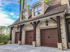 Create a rustic but elegant exterior by combining all the right elements: Dark timbers and stained triple garage doors perfectly accent Pine Hall Oyster brick. Stained Brick Exterior, Brown Brick Exterior, Brown Brick Houses, Stone Exterior Houses, Garage Exterior, Rustic Exterior, Craftsman Exterior, Exterior Remodel, Dream House Exterior