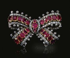 Ruby and diamond bow brooch, mid 19th century Designed as a ribbon tied bow set with graduated lines of oval rubies mounted in cut-down collets bordered with lines of old-mine and circular-cut diamonds.
