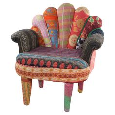 Crafted from mango wood with a peacock-style back and vintage kantha cloth upholstery, this one-of-a-kind arm chair brings bright bohemian-inspired style to ...