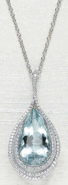 MARGHERITA BURGENER An Aquamarine and Diamond Pendant Necklace  Designed as a pear-shaped aquamarine pendant, weighing approxmately 20.56 carat, within a pavé-set diamond openwork surround, from a fine link chain, accented by spectacle-set diamonds, mounted in 18K white gold,  length 19 inches, pendant drop 2 inches. Signed 'Margherita Burgener' with a Margherita  Burgener box.