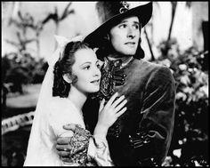 """Olivia de Havilland and Errol Flynn in """"Captain Blood"""""""