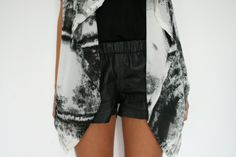 leather shorts with a printed blouse