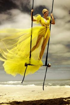 Be careful fabulous lady! There's no net under you! Your dress is fabulous blowing in the wind!