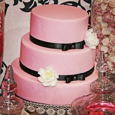 Pink 3 tier cake with black ribbon