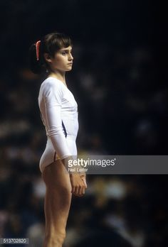View of Romania Nadia Comaneci during Women's competition at Montreal Forum. Montreal, Canada - ) Get premium, high resolution news photos at Getty Images Artistic Gymnastics, Olympic Gymnastics, Olympic Sports, Nadia Comaneci Perfect 10, Girl Anatomy, Gym Leotards, Tennis, Female Gymnast, Namaste Yoga