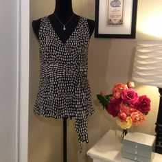 Ann Taylor darling sleeveless top  Delicate, frilly blouse - a great example of quality clothing the Ann Taylor line is known for.  Side zip for perfect size 8 fit.  Scarf/bow detailing at waist.   Ann Taylor Tops Blouses