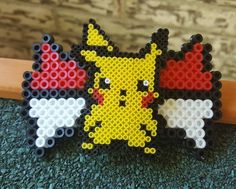 A mini and midi perler combo hair clip. #handmade #perler #perlerbeads #pokemon #pikachu #miniperler #hairbows #pokemongo