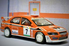 Scalextric Altaya DM-14. Mitsubishi Lancer EVO VI. Rally Portugal 2001. T. Mäkinen/R. Mannisenmaki. #slot #slotcar Lancer Evo, Ho Slot Cars, Subaru, Rally, Trains, Buildings, Hobbies, Dreams, Collection