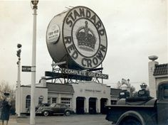 """Red Crown Service Station at Skinker and Clayton Roads. [Charlie Mudd Standard Service """"The Station With the Big Sign""""]. 981 South Skinker Boulevard. (1946) ©Missouri History museum"""