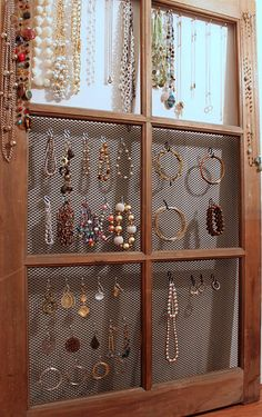 Great jewelry organizer made from an antique window...THIS IS REALLY CUTE AND EASY TO MAKE! take out the glass and use screen or you could put mirror tiles in place of glass and use tea cup hooks to hold necklaces....awsome...a lot of ideas for this one....