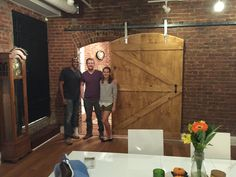 Midtown client enjoys custom built Arched Barn door from Cowboy Jeff. Custom barn door hardware and Summer Oak stain by Varathane. Notice how the door is arched to match the 100 year old brick walls. www.cowboybuilds.com