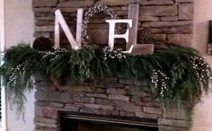 DIY Mantle decor made of repurposed pallets...live cypress garland