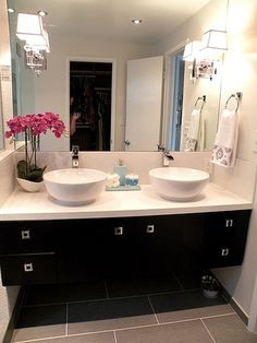 Dark vanity, white counter/bowls, grey floor master bathroom