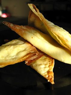 Easy, baked cream cheese wontons with garlic scapes and green onions.